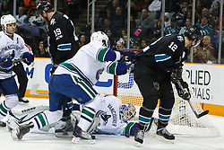 January 3, 2011; San Jose, CA, USA; Vancouver Canucks goalie Cory Schneider (35) saves a shot from San Jose Sharks center Patrick Marleau (12) during the first period at HP Pavilion. Mandatory Credit: Jason O. Watson / US PRESSWIRE