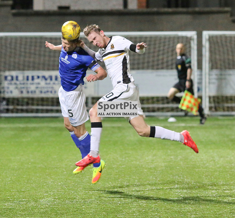 Darren Brownlie heads clear from Robert Thomson during the Queen of the South v Dumbarton Scottish Championship 03 December2016 <br /> <br /> (c) Andy Scott | SportPix.org.uk