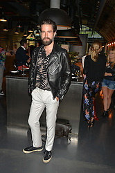 JACK GUINNESS at a party to launch the Amazon Fashion Photography Studio at 383 Geffrye Street, London E2 on 23rd July 2015.