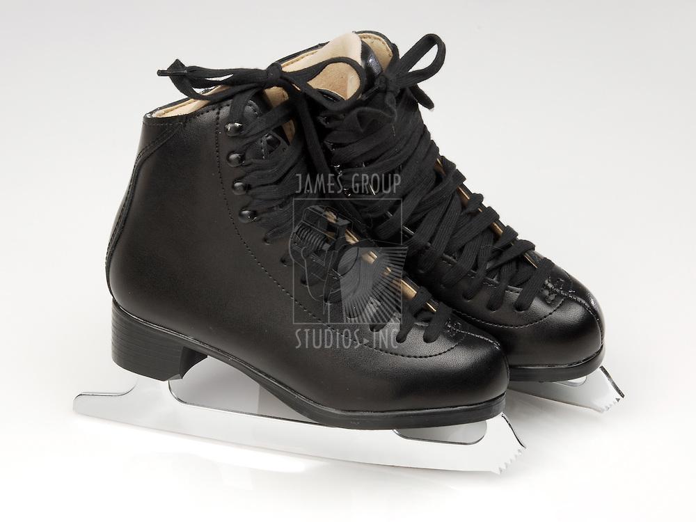 black pair of ice skates on ice