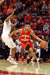 26 November 2016:  Drew Cushingberry turns the corner at the baseline passing by DJ Clayton(2) during an NCAA  mens basketball game between the Ferris State Bulldogs the Illinois State Redbirds in a non-conference game at Redbird Arena, Normal IL