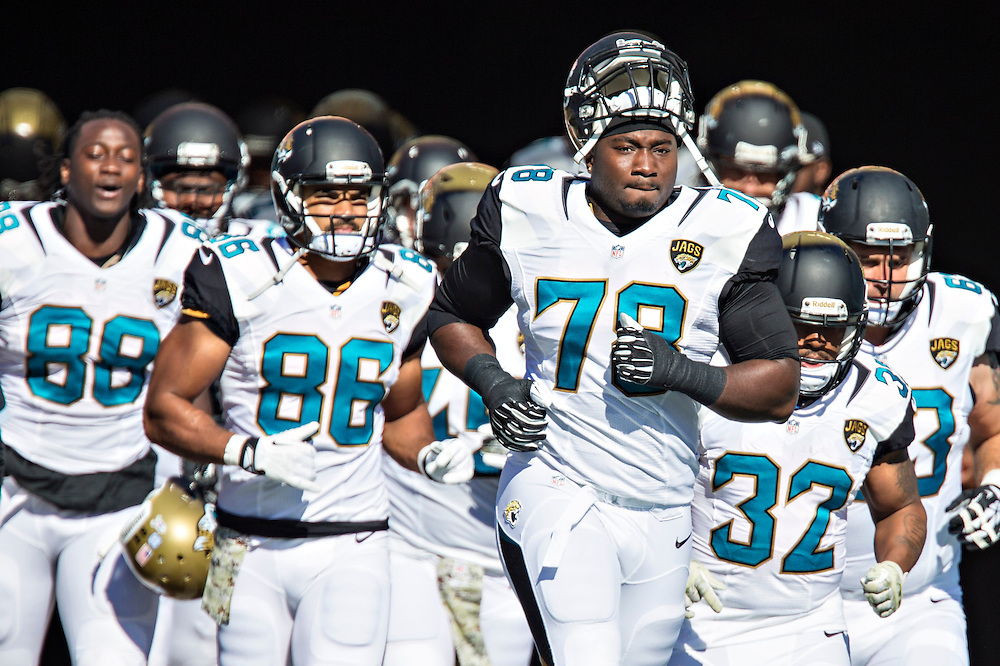 NASHVILLE, TN - NOVEMBER 10:  Cameron Bradfield #78 of the Jacksonville Jaguars leads his team onto the field before a game against the Tennessee Titans at LP Field on November 10, 2013 in Nashville, Tennessee.  The Jaguars defeated the Titans 29-27.  (Photo by Wesley Hitt/Getty Images) *** Local Caption *** Cameron Bradfield