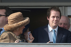 The Duchess of Cornwall collects her winnings from her son Tom Parker Bowles as she has a winner in the first race at the Cheltenham Festival Ladies Day. Cheltenham Racecourse, Cheltenham, United Kingdom. Wednesday, 12th March 2014. Picture by i-Images