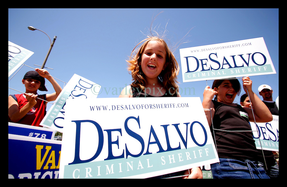 April 22nd, 2006. New Orleans, Louisiana. Voting day. Children wave political placards close to one of the mega polling stations set up at the University of New Orleans.