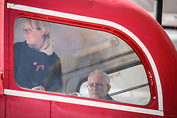 © Licensed to London News Pictures. 01/05/2016. London, UK. Jeremy Corbyn, Leader of the Labour Party, waits in the back of a double decker bus before speaking at the opening May Day rally. Thousands gathered on Clerkenwell Green to mark May Day. Photo credit : Rob Pinney/LNP