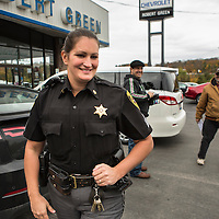 ​Sergeant Crumley smiles while walking away after she jokes with two men who accidentally tripped an alarm at the local car dealership while looking at vehicles. While investigating the call, a local teacher happened to be in the area and described Cheryl as one of Sullivan County's finest, also serving as a School Resource Officer for the local elementary school.