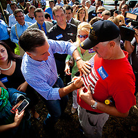 TAMPA, FL -- September 2, 2011 -- Republican presidential candidate, former Massachusetts Gov. Mitt Romney, signs the shirt of Mike Freese of St. Petersburg as he greets staff and supporters at his new campaign headquarters in downtown Tampa, Fla., on Friday ,September 2, 2011 .