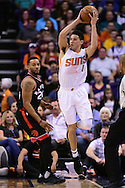Dec 29, 2016; Phoenix, AZ, USA;  Phoenix Suns guard Devin Booker (1) saves the basketball from going out of bounds in front of Toronto Raptors guard Norman Powell (24)  in the first half of the NBA game at Talking Stick Resort Arena. The Suns won 99-91. Mandatory Credit: Jennifer Stewart-USA TODAY Sports