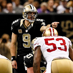 November 25, 2012; New Orleans, LA, USA; New Orleans Saints quarterback Drew Brees (9) signals against the San Francisco 49ers during the second half of a game at the Mercedes-Benz Superdome. The 49ers defeated the Saints 31-21. Mandatory Credit: Derick E. Hingle-US PRESSWIRE