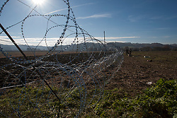 Licensed to London News Pictures. 11/11/2015. Gibina, Slovenia. Migrant crisis at the Slovenian - Croatian border. Slovenian army set up barbed wire fences on the Slovenian-Croatian border crossing Gibina Photo: Marko Vanovsek/LNP