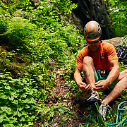North Baldcap rock climber tying his shoe