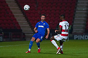 AFC Wimbledon defender Luke O'Neill (2) passes the ball during the The FA Cup match between Doncaster Rovers and AFC Wimbledon at the Keepmoat Stadium, Doncaster, England on 19 November 2019.