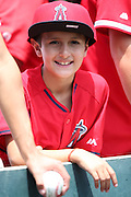 ANAHEIM, CA - JULY 20:  A young fan smiles during the Los Angeles Angels of Anaheim game against the Seattle Mariners at Angel Stadium on Sunday, July 20, 2014 in Anaheim, California. The Angels won the game 6-5. (Photo by Paul Spinelli/MLB Photos via Getty Images)