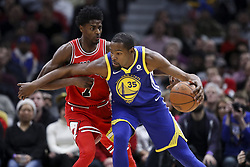 January 17, 2018 - Chicago, IL, USA - Golden State Warriors forward Kevin Durant (35) drives against Chicago Bulls guard Justin Holiday (7) during the first half at the United Center in Chicago on Wednesday, Jan. 17, 2018. The Warriors won, 119-112. (Credit Image: © Armando L. Sanchez/TNS via ZUMA Wire)