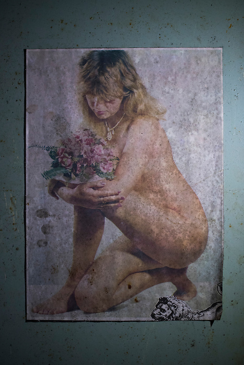 A weathered pinup photo dating to Soviet times is seen at Azov Engineering Group's garage on September 9, 2015 in Kyiv, Ukraine. The battalion's base was formerly a factory producing tractors and construction equipment and many remnants of the areas former tenants still remain.