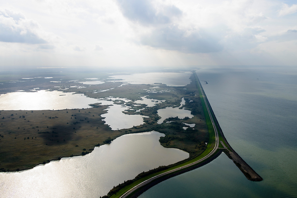 Nederland, Flevoland, Almere, 10-10-2014; Oostvaardersdijk en Oostvaarderplassen. Almere aan de vere horizon, rechts Markermeer.<br /> Bird sanctuary and nature reserve Oostvaardersplassen.<br /> luchtfoto (toeslag op standard tarieven);<br /> aerial photo (additional fee required);<br /> copyright foto/photo Siebe Swart