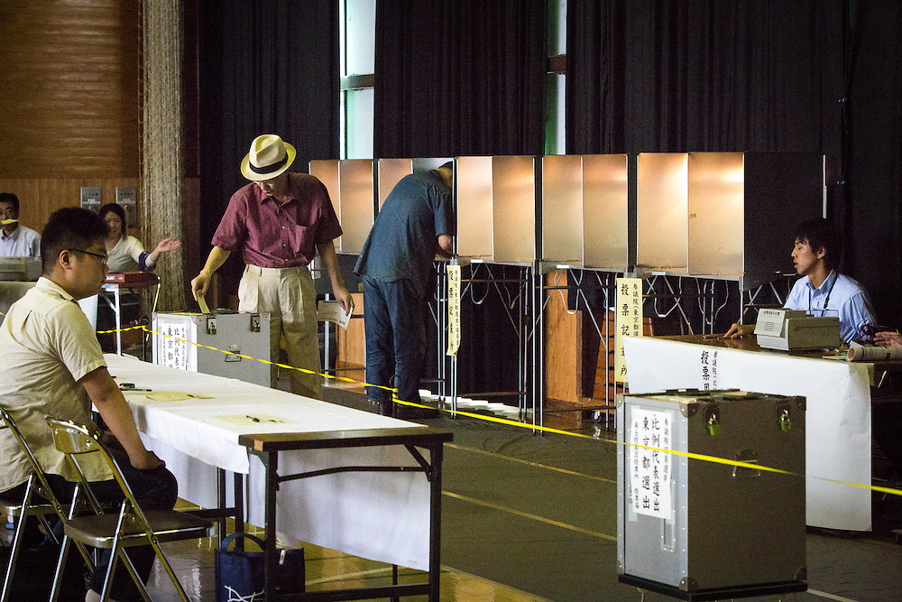 TOKYO, JAPAN - JULY 10 : A man cast her ballots to vote for parliament's upper house election at a polling station in Tokyo, Japan on Sunday, July 10, 2016. The revised law has expanded the electorate by 2.4 million people aged 18 and 19, and is designed to give more political say to younger generations. The first Upper house election nation-wide in Japan that 18 years old can vote after government law changes its voting age from 20 years old to 18 years old. (Photo by Richard Atrero de Guzman/NUR Photo)