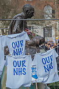 Undert Gandi's watchful eye - A march against cuts to and potential privatisation of the NHS starts in Tavistock Square and heads for Parliament Square. The march was organised by the peoples assembly and supported by most major unions and the Labour Party.