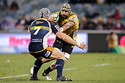 Blade Thomson takes on David Pocock during the Super Rugby match, Brumbies V Hurricanes, GIO Stadium, Canberra, Australia, 30th June 2018.Copyright photo: David Neilson / www.photosport.nz