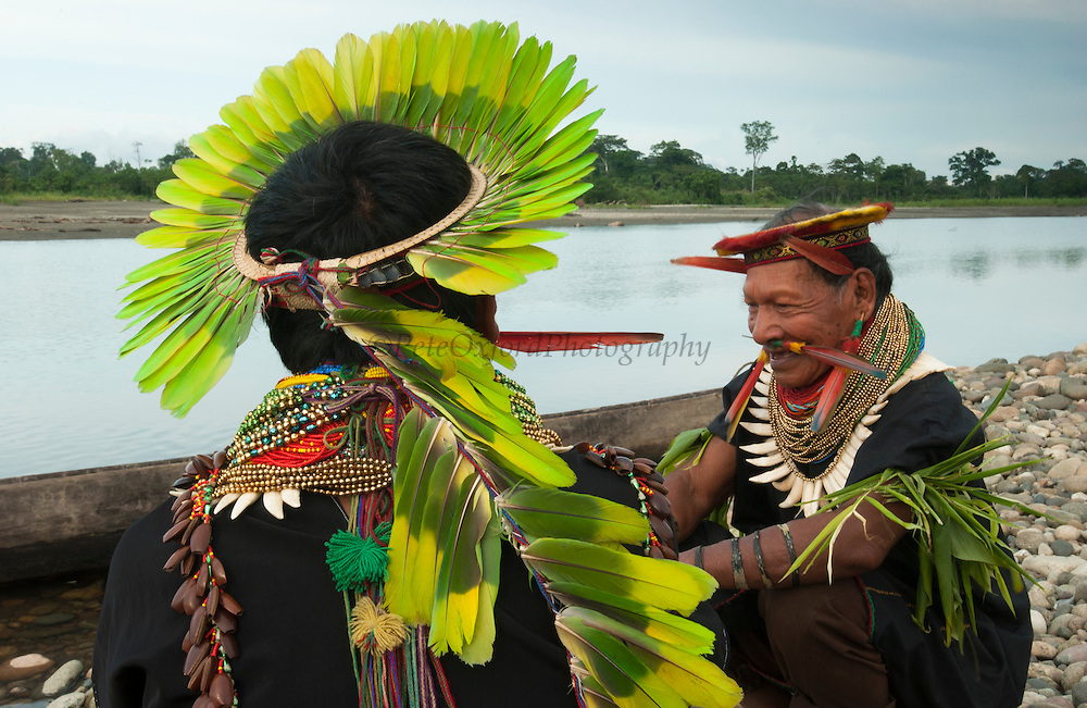 Cofan Indians from Dureno Community wearing traditional dress<br /> Atanacio Criollo & Alejandro Criollo<br /> Agua Rico River near Dureno Amazon Rain Forest ECUADOR South America<br /> Crown made from Mealy (Amazon) Parrot feathers - (Amazona farinosa) Necklace of beads & peccary teeth, arm bands of palm leaves and snake skin.<br /> This is the tribe who are fighting TEXACO oil company about damage done to their land from drilling and bad waste disposal