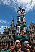 Catalan activists gather for the Castellers de Vilafranca building of a Castell, or traditional human tower, in the Grand Place, Brussels, on June 8 2014 as part of a day or actions across Europe calling for Catalan independence from Spain. A referendum on the issue is being called for on November 9 2014, but is being blocked by the Spanish government. Similar castell events were helping in Berlin, Geneva, Lisbon, London, Paris, Rome and Barcelona.
