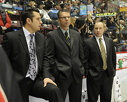 Team OHL coaches Bob Bougner of the Windsor Spitfires, Dave Cameron of the Mississauga St. Michael's Majors and Steve Spott of the Kitchener Rangers in Game 4 of the CHL's SUBWAY Super Series in Windsor, ON on Monday. Photo by Aaron Bell/OHL Images.