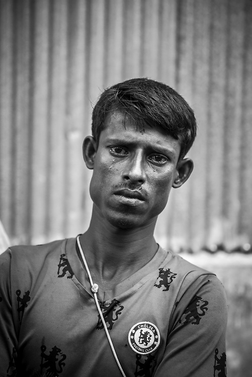 Mohamed Salim, a 30-year-old Rohingya man who had just reached Kutupalong refugee camp in Bangladesh after a 17-day walk from Myanmar with his family and neighbors, cries after showing a photographer cell phone pictures of the house and cows — the life — he left behind. Mohamed Salim is mute, which made his tears all the more poignant. (October 29, 2017)
