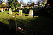 France, Thu 9 Dec. 2010: View from the gravestone of Captain Osbert Harold Brown, DSO, MC, back towards memorial in the Brewery Orchard Cemetery in Bois Grenier. The cemetery contains the graves of 201 British, 125 Australian, 13 New Zealand and 5 German soldiers from the First World War.