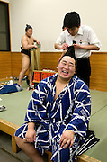 "ASASHORYU - SUMO wrestler with the highest rank of ""YOKOZUNA"", in a changing room of the TOKYO kyokai (sumo stadium), before the retirement ceremony of the wrestler Toki, while a sumo hairdresser is taking care of his hairstyle. Tokyo 27 January 2007"