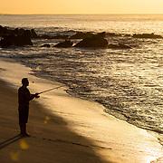 Man fishing from shore.