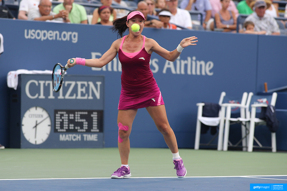 Jie Zheng, China, in action during her third set tie break victory over Venus Williams, USA,  on Louis Armstrong Stadium during the Women's Singles competition at the US Open. Flushing, New York, USA. 28th August 2013. Photo Tim Clayton