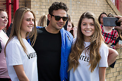 © Licensed to London News Pictures . 02/08/2015 . Droylsden Football Club , Manchester , UK . RYAN THOMAS poses with fans . Celebrity football match in aid of Once Upon a Smile and Debra , featuring teams of soap stars . Photo credit : Joel Goodman/LNP