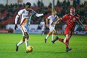 'Bradford City forward, on loan from Huddersfield Town, Jordy Hiwula (11) gets through on goal as his shot rebounds off the goalkeeper, but he puts the ball in to make the sore 1-1 during the EFL Sky Bet League 1 match between Walsall and Bradford City at the Banks's Stadium, Walsall, England on 17 December 2016. Photo by Simon Davies.