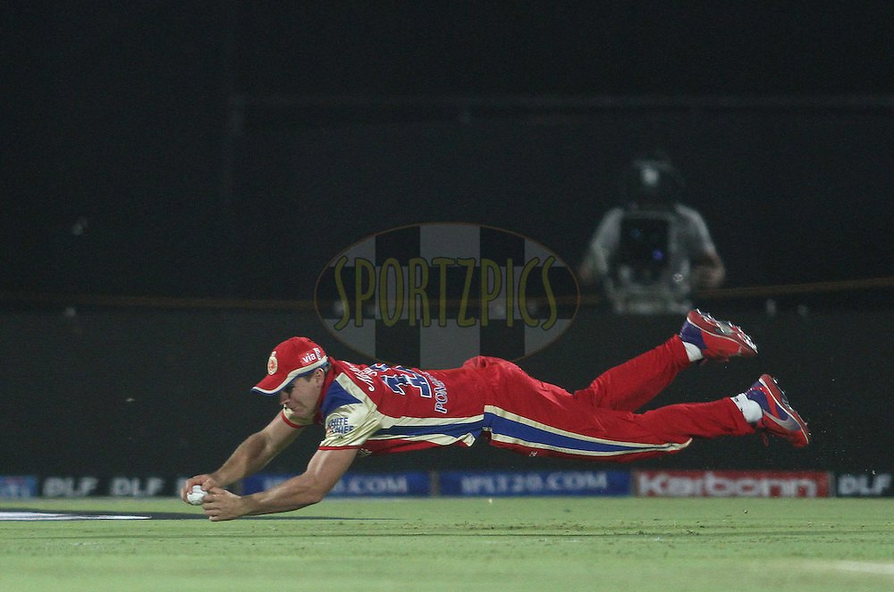 Luke Pomersbach of the Royal Challengers Bangalore makes a diving stop during match 30 of the the Indian Premier League (IPL) 2012  between The Rajasthan Royals and the Royal Challengers Bangalore held at the Sawai Mansingh Stadium in Jaipur on the 23rd April 2012..Photo by Shaun Roy/IPL/SPORTZPICS