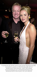 TV presenter LES DENNIS and his wife actress AMANDA HOLDEN, at a party in London on 23rd October 2001.	OTI 13