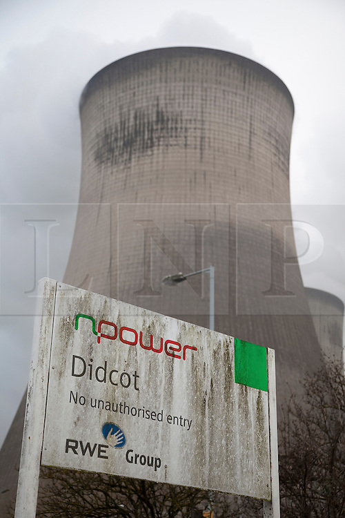 © Licensed to London News Pictures. File pic dated 22/03/2013. Didcot,  UK. Npower signs outside Didcot Power Station in Oxfordshire, which has now closed down. Npower have today (21/10/2013) announced that they will increase energy prices by 10.4% from 1st December 2013. Photo credit : Rob Arnold/LNP