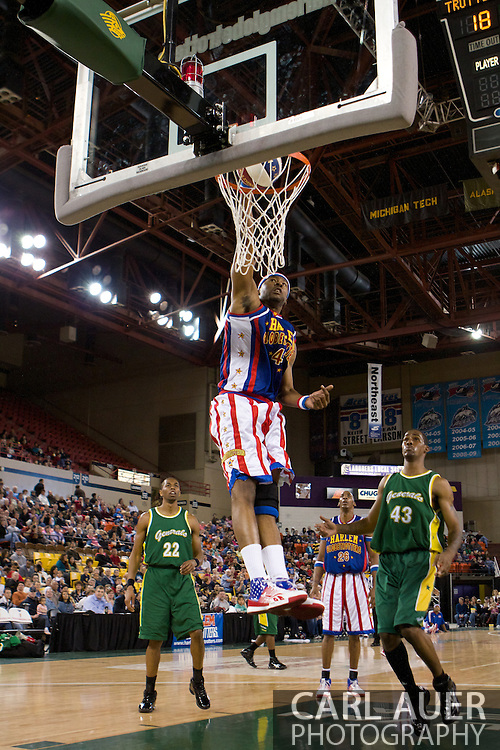 April 30th, 2010 - Anchorage, Alaska:  Harlem Globetrotter Hawk (43) flies through the Washington General defense for a one handed dunk.