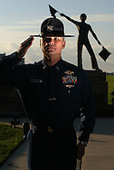 Petty Officer John D. Workman salutes in front of statue of the only USCG Medal of Honor winner Douglas A. Munro during boot camp at The United States Coast Guard Training Center, Cape May, NJ.
