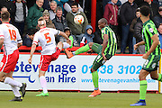 Tom Elliott forward for AFC Wimbledon (9) and Fraser Franks defender of Stevenage FC (5) during the Sky Bet League 2 match between Stevenage and AFC Wimbledon at the Lamex Stadium, Stevenage, England on 30 April 2016. Photo by Stuart Butcher.