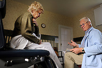 REEDVILLE, VA - DECEMBER 5:   Doctor Emory Lewis speaks to patient, Brenda Jones, about medication during an exam, in Reedville, Virginia, Monday, December 5, 2011. The only doctor in the small fishing community, Doctor Lewis takes care of primarily Medicare  patients out of an old farm house clinic.   (Photo by Melina Mara/The Washington Post) . ...