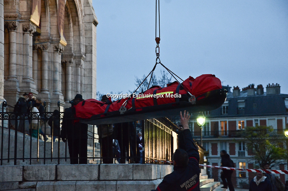 Dec. 15, 2015 - Paris, France - <br /> <br /> Special forces rescue operation in Paris<br /> <br /> A special forces rescues a sick man from the top of the Sacre-Coeur basilic in Montmartre, Paris on December 15, 2015 <br /> ©Exclusivepix Media