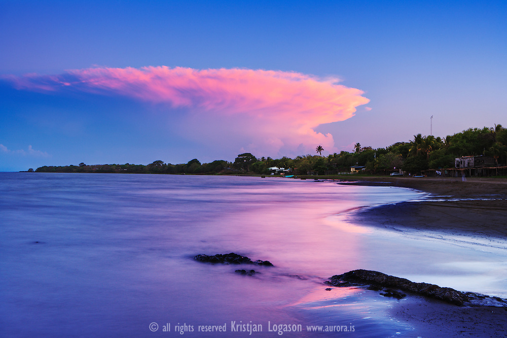 Sunset at Lake Nicaragua and the beach of San Jorge..the largest of several freshwater lakes in southwestern Nicaragua and the dominant physical feature of the country. It is also the largest lake in Central America. Its indigenous name is Cocibolca, and the Spanish called it Mar Dulce?both terms meaning ?sweet sea.? Its present name is said to have been derived from that of Nicarao, an Indian chief whose people lived on the lake's shores...Lake Nicaragua (Spanish: Lago de Nicaragua, Lago Cocibolca, Mar Dulce, Gran Lago, Gran Lago Dulce, or Lago de Granada) is a vast freshwater lake in Nicaragua of tectonic origin. With an area of 8,264 km2 (3,191 sq mi), it is the largest lake in Central America, the 19th largest lake in the world (by area) and the 9th largest in the Americas. It is slightly smaller than Lake Titicaca. With an elevation of 32.7 metres (107 ft) above sea level, the lake reaches a depth of 26 metres (85 ft). It is intermittently joined by the Tipitapa River to Lake Managua...The lake drains to the Caribbean Sea via the San Juan River, historically making the lakeside city of Granada, Nicaragua, an Atlantic port although it is closer to the Pacific. The lake has a history of Caribbean pirates who assaulted nearby Granada on three occasions. Despite draining into the Caribbean Sea, the Pacific Ocean is near enough to be seen from the mountains of Ometepe (an island in the lake)...Before construction of the Panama Canal, a stagecoach line owned by Cornelius Vanderbilt's Accessory Transit Company connected the lake with the Pacific across the low hills of the narrow Isthmus of Rivas. Plans were made to take advantage of this route to build an interoceanic canal, the Nicaragua Canal, but the Panama Canal was built instead. In order to quell competition with the Panama Canal, the U.S. secured all rights to a canal along this route in the Bryan-Chamorro Treaty of 1916. However, since this treaty was mutually rescinded by the United States and Nicaragua in 1