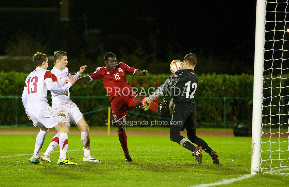 CONNAH'S QUAY, WALES - Thursday, March 20, 2014: Wales' Ibi Sosani sees his shot saved by Poland's goalkeeper Kacper Chorazka during the Under-15's International Friendly match at the Deeside Stadium. (Pic by David Rawcliffe/Propaganda)