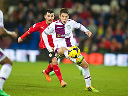 CARDIFF, WALES - Tuesday, February 11, 2014: Aston Villa's Ashley Westwood in action against Cardiff City during the Premiership match at the Cardiff City Stadium. (Pic by David Rawcliffe/Propaganda)