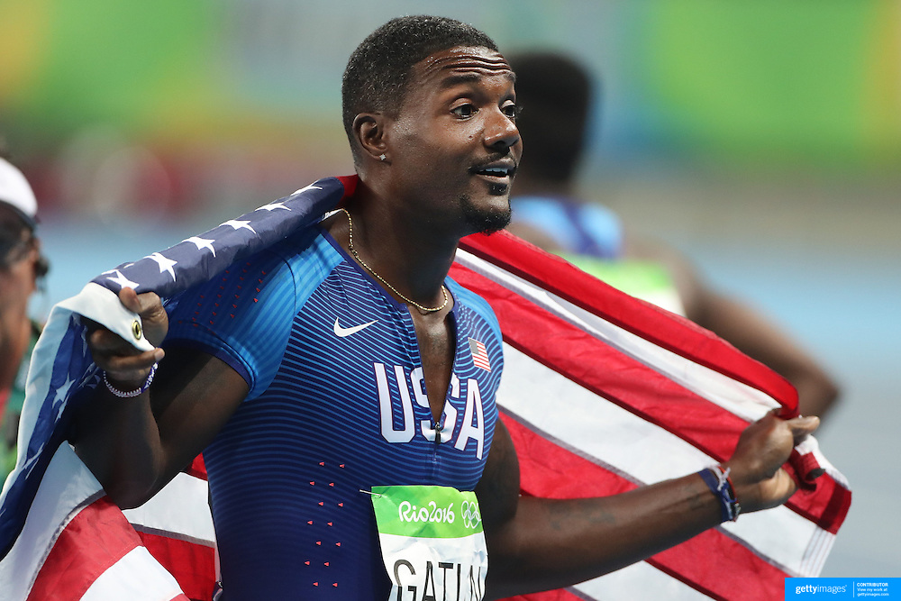 Athletics - Olympics: Day 9  Justin Gatlin of the United States celebrates after winning the silver medal in the Men's 100m Final at the Olympic Stadium on August 14, 2016 in Rio de Janeiro, Brazil. (Photo by Tim Clayton/Corbis via Getty Images)
