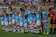 Manchester City Women take the field with young soccer fans prior to their game with the North Carolina Courage during an International Champions Cup women's soccer game, Thurday, Aug. 15, 2019, in Cary, NC. The North Carolina Courage defeated Manchester City Women 2-1.  (Brian Villanueva/Image of Sport)