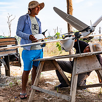 Martín Pillaca, GIS Specialist at CINCIA, (right) helps prepare the fixed wing drone for its next mapping flight over La Pampa. Following Peru's February 2019 militarized crackdown on illegal and unofficial alluvial gold mining in the La Pampa region of Madre de Dios, Wake Forest University's Puerto Maldonado-based Centro de Innovación Científica Amazonia (CINCIA), a leading research institution for the development of technological innovation for biological conservation and environmental restoration in the Peruvian Amazon, is applying years of scientific research and technical experience related to understanding mercury contamination and managing Amazonian ecosystems. What they learn will help guide urgent remediation, restoration, and reforestation efforts that can also serve as models for how we address the tropic's most dramatically devastated landscapes around the world. La Pampa, Madre de Dios, Peru.