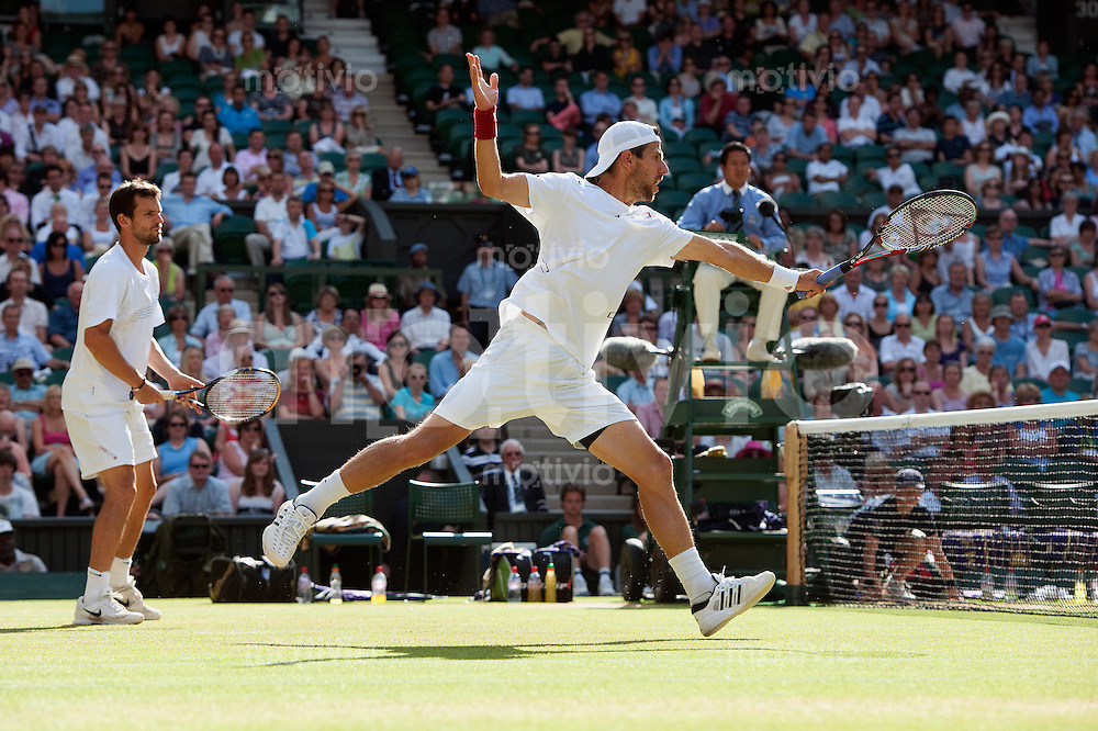 The Final of the Gentlemens Doubles Robert Lindstedt (SWE) and Horia Tecau (ROU) play against Juergen Melzer (AUT) and Philipp Petzschner (GER) on Centre Court. The Wimbledon Championships 2010 The All England Lawn Tennis & Croquet Club  Day 12 Saturday 03/07/2010