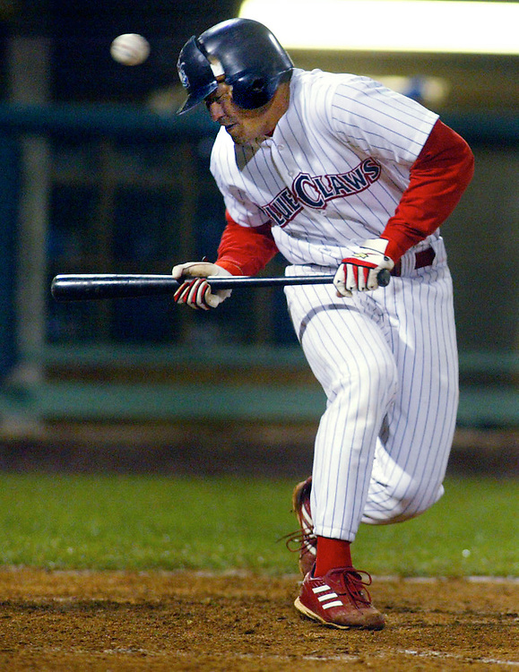 (SPORTS) Lakewood 4/26/2003  The Blueclaws G.G. Sato gets hits in the head so hard that his helmet the shatters.  Michael J. Treola Staff Photographer....MJT