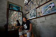 Mr. Shi Bo, a former racer and Guru of Beijing's growing underground road cycling scene, poses in front of his collection of European and Chinese race bicycles stored in a warehouse near his home.
